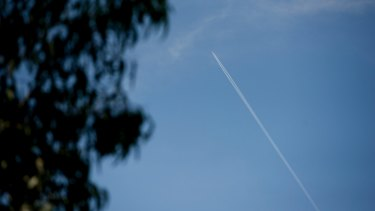 Contrails behind a plane flying over Canberra.