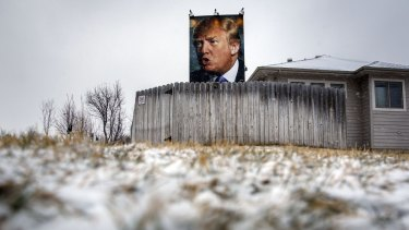 A poster of Donald Trump outside a home in West Des Moines, Iowa, on Monday.