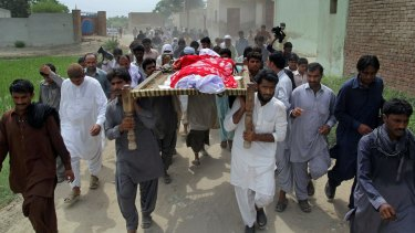 Relatives and local residents carry the coffin of slain model Qandeel Baloch for funeral prayers in Shah Sadar Din village, near Dera Ghazi Khan, Pakistan.