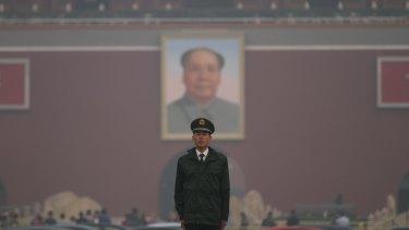 Smog blankets Tiananmen Square in Beijing last year.