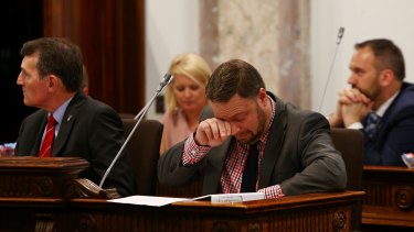 Deputy Mayor Adrian Schrinner wipes away tears after his speech during a 'Condolence Motion' for Manmeet Sharma.