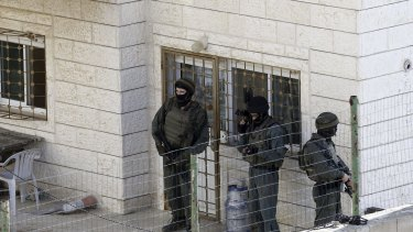 Israeli troops outside the Abu Jamal home in the aftermath of the attack.