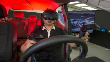 Eric Huang uses virtual reality goggles to help design car interiors at Holden's Port Melbourne plant.
