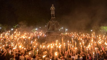 Torch-bearing white nationalists rally around a statue of Thomas Jefferson near the University of Virginia campus in Charlottesville.