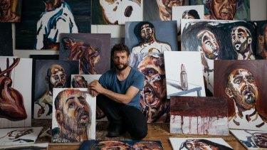 Artist Ben Quilty surrounded by works painted by Myuran Sukumaran, which will be exhibited at Campbelltown Arts Centre as part of the 2017 Sydney Festival.