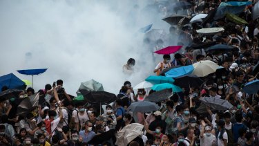 Police fire tear gas at demonstrators during a protest near central government offices in Hong Kong.