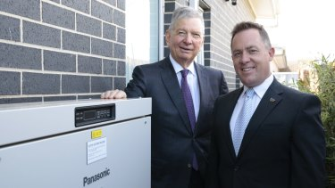 ActewAGL CEO Michael Costello and Panasonic Australia's managing director Paul Reid with a battery storage system at a home in Forde.