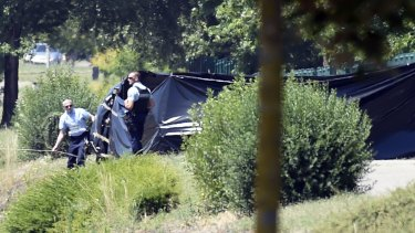 French security at the enclosed area where a decapitated body was found.
