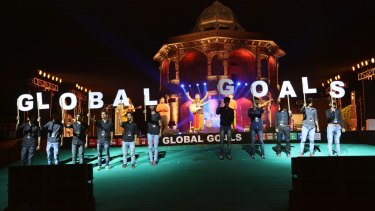 "People hold up letters spelling ""global goals"" during the Delhi Action 2015 Global mobilisation event last month."