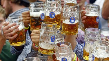 People celebrate the opening of the 182nd Oktoberfest beer festival in Munich, southern Germany, in September.
