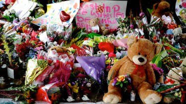 Teddy bears and flowers left for the eight children killed in a Cairns home.