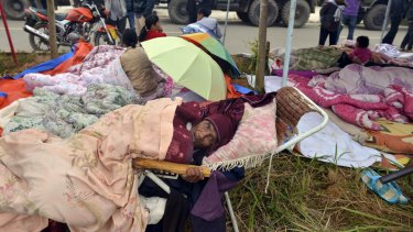 Outdoor respite: Residents rest outdoor in the aftermath of an earthquake in the town of Yongping in south-west China's Yunnan province.