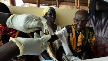 A Medecines Sans Frontieres (MSF) health worker tests villagers for malaria in South Sudan.