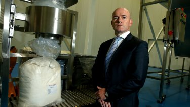TPI Enterprises Managing Director Jarrod Ritchie with a bag of thebaine, a narcotic raw material, which has a commercial value of about $US600 a kilogram.