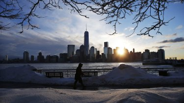 Financial professionals planned to work from home or in remote offices, as the storm threatens to dump up to 3 feet of snow on the US East Coast.