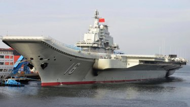 China's aircraft carrier, the Soviet-built Liaoning, berthed in a port of China.