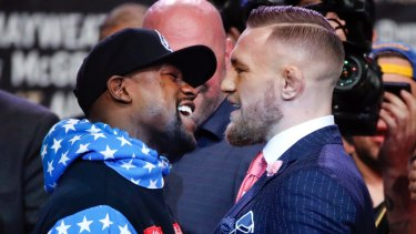 Fighters Floyd Mayweather jnr and Conor McGregor get up close and personal.