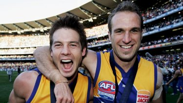 Ben Cousins and Chris Judd during happier times celebrating the Eagles' 2006 grand final win.