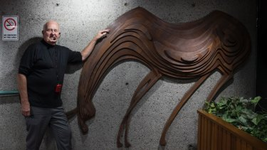Architect Tao Gofers with the animal sculpture, designed by Penny Rosier, which greets visitors in the foyer.
