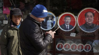 Souvenir plates bearing images of Chinese President Xi Jinping and former leaders including Mao Zedong at a shop near Tiananmen Square in Beijing last month.