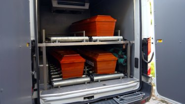 The coffins of mother Rehan Kurdi, and Syrian boys Aylan, 3, and Galip, 5, are placed in a funeral vehicle.