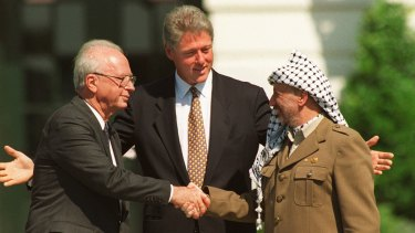 US president Bill Clinton with Rabin and Palestine Liberation Organisation chairman Yasser Arafat mark the signing of the first Oslo peace accord with a handshake at the White House in September 1993.