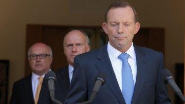 Seeking an election trigger? Prime Minister Tony Abbott with senators Eric Abetz and George Brandis.