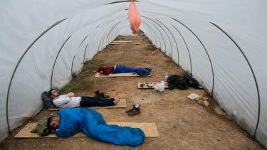 Jewish settlers sleep under plastic  at Amona, an outpost in the Israeli-occupied West Bank. Israel's Supreme Court has repeatedly called for the outpost's demolition, but the government has sought to postpone any action against the settlers.