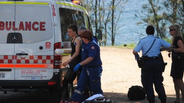 Paramedics with the injured teen at Mollymook.