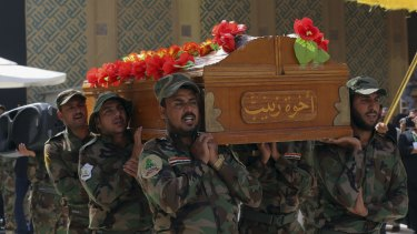 Members of the Shiite militia Asaib Ahl al-Haq carry the coffin of a fighter killed in clashes with Islamic State at a funeral in the Iraqi city of Najaf last week.