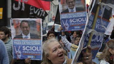 Supporters of presidential candidate Daniel Scioli gather in Buenos Aires on Sunday.