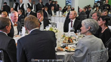 Briefly US national security advisor Michael Flynn sits next to Russian President Vladimir Putin at an event celebrating RT in Moscow.