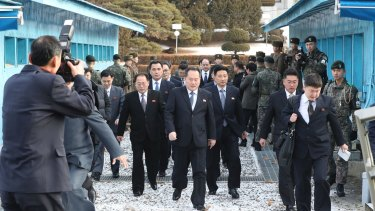 The head of North Korean delegation Ri Son-gwon, centre, arrives at the South side for the meeting in Paju on Tuesday.