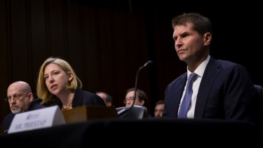 Jeanette Manfra of the Department of Homeland Security speaks while Bill Priestap, of the FBI, right, listens during a congressional hearing on sanctions against Russia.