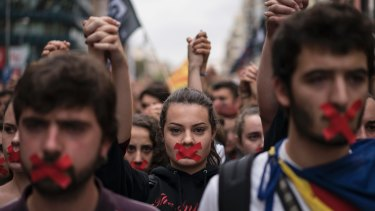 Independence supporters march during a demonstration in downtown Barcelona on Monday.