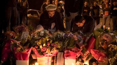 Maaz Yousafzai, left, at the candlelight vigil.