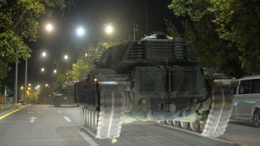Turkish army tanks move in the main streets in the early morning hours of Saturday in Ankara, Turkey.