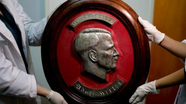 A relief portrait of Adolf Hitler was among the Nazi artifacts believed to have been taken to Argentina by fugitive Germans.