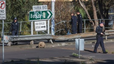 The car plunged into the Yarra River through road barriers on Yarra Boulevard.