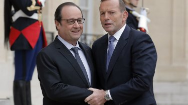 French President Francois Hollande welcomes Prime Minister Tony Abbott to the Elysee Palace, in Paris, on Monday.