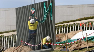 The security fence is installed across the lawns of Parliament House in Canberra.