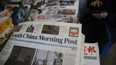 Copies of the South China Morning Post are sold at a news stand in Hong Kong. Chinese e-commerce giant Alibaba says it is buying Hong Kong's leading English language newspaper.