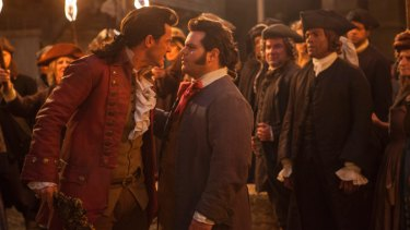 Show stealers: Luke Evans as Gaston and Josh Gad (left) as Lefou.