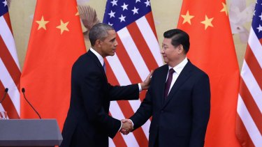 US President Barack Obama shakes hands with Chinese President Xi Jinping last week.