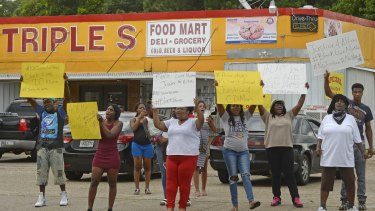 Family and friends of Alton Sterling protest on Tuesday afternoon.