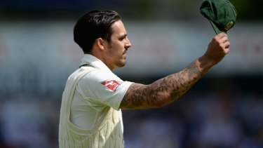 Mitchell Johnson of Australia salutes the crowd after reaching his century of runs conceded.