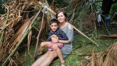 Angela Boyson and her son Oscar with their cubby at Melbourne's Royal Botanic Gardens.