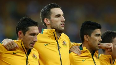 European exit: Socceroo Matthew Spiranovic (centre) leads the defence of Hangzhou Greentown.