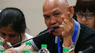 Saldy delos Santos talks about his late son Kian Loyd delos Santos during a senate committee hearing on Thursday.