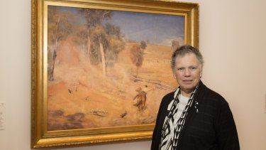 National Gallery of Australia curator Dr Anna Gray with the Tom Robert's painting A break away!